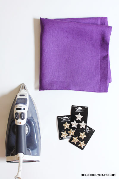 In this photo Manal Aman shows how to make DIY throw pillows with gold stars for Ramadan and Eid on Hello Holy Days using purple pillow cases, an iron and appliques.