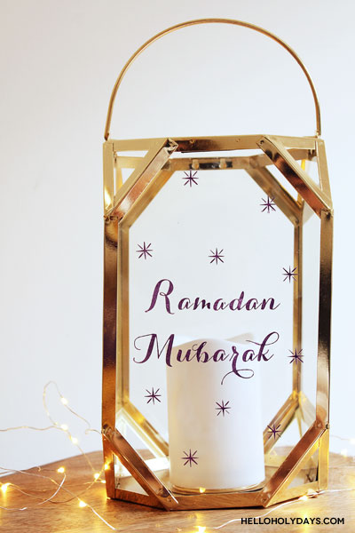 Manal Aman of Hello Holy Days! transforms a store bought lantern from HomeSense into a Ramadan lantern using stencils from Martha Stewart Crafts.